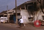 Image of Vietnamese people Saigon Vietnam Bien Hoa Air Base, 1968, second 42 stock footage video 65675052389