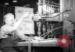 Image of war production workers at aircraft factory Long Beach California USA, 1942, second 5 stock footage video 65675052407