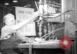Image of war production workers at aircraft factory Long Beach California USA, 1942, second 14 stock footage video 65675052407