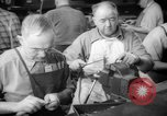 Image of war production workers at aircraft factory Long Beach California USA, 1942, second 27 stock footage video 65675052407