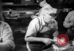 Image of war production workers at aircraft factory Long Beach California USA, 1942, second 35 stock footage video 65675052407