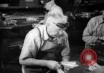 Image of war production workers at aircraft factory Long Beach California USA, 1942, second 36 stock footage video 65675052407