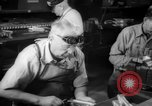 Image of war production workers at aircraft factory Long Beach California USA, 1942, second 37 stock footage video 65675052407