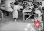 Image of Goodyear factory interiors Akron Ohio USA, 1942, second 55 stock footage video 65675052416