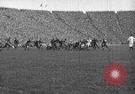 Image of First football game in 1927 at new Michigan Stadium Ann Arbor Michigan USA, 1927, second 32 stock footage video 65675052490