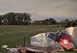 Image of wrecked trailer home Rapid City South Dakota USA, 1972, second 33 stock footage video 65675052543