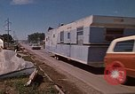 Image of wrecked trailer home Rapid City South Dakota USA, 1972, second 52 stock footage video 65675052543