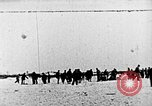 Image of Parachutist jumps from airship New York United States USA, 1918, second 1 stock footage video 65675052580