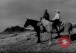 Image of cowboys on ranch United States USA, 1940, second 2 stock footage video 65675052587