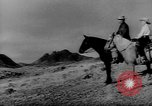 Image of cowboys on ranch United States USA, 1940, second 3 stock footage video 65675052587