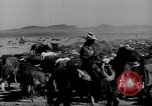 Image of cowboys on ranch United States USA, 1940, second 7 stock footage video 65675052587
