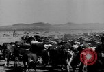 Image of cowboys on ranch United States USA, 1940, second 8 stock footage video 65675052587