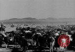Image of cowboys on ranch United States USA, 1940, second 9 stock footage video 65675052587