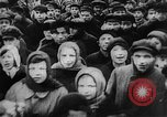 Image of massed crowd parading Moscow Russia Soviet Union, 1924, second 15 stock footage video 65675052607