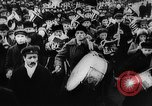 Image of massed crowd parading Moscow Russia Soviet Union, 1924, second 44 stock footage video 65675052607