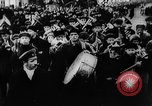 Image of massed crowd parading Moscow Russia Soviet Union, 1924, second 52 stock footage video 65675052607
