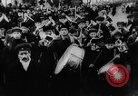 Image of massed crowd parading Moscow Russia Soviet Union, 1924, second 53 stock footage video 65675052607