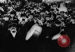 Image of massed crowd parading Moscow Russia Soviet Union, 1924, second 54 stock footage video 65675052607