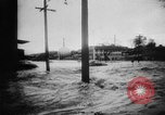 Image of rapid flowing water in streets United States USA, 1955, second 14 stock footage video 65675052615