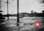 Image of rapid flowing water in streets United States USA, 1955, second 15 stock footage video 65675052615