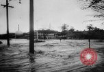 Image of rapid flowing water in streets United States USA, 1955, second 16 stock footage video 65675052615