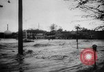 Image of rapid flowing water in streets United States USA, 1955, second 17 stock footage video 65675052615