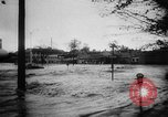 Image of rapid flowing water in streets United States USA, 1955, second 18 stock footage video 65675052615
