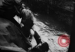 Image of rapid flowing water in streets United States USA, 1955, second 20 stock footage video 65675052615