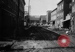 Image of rapid flowing water in streets United States USA, 1955, second 22 stock footage video 65675052615