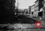 Image of rapid flowing water in streets United States USA, 1955, second 23 stock footage video 65675052615