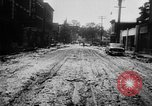 Image of rapid flowing water in streets United States USA, 1955, second 25 stock footage video 65675052615