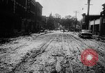 Image of rapid flowing water in streets United States USA, 1955, second 26 stock footage video 65675052615