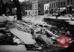 Image of rapid flowing water in streets United States USA, 1955, second 34 stock footage video 65675052615