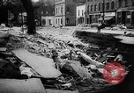 Image of rapid flowing water in streets United States USA, 1955, second 35 stock footage video 65675052615