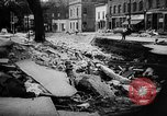 Image of rapid flowing water in streets United States USA, 1955, second 36 stock footage video 65675052615