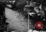 Image of rapid flowing water in streets United States USA, 1955, second 41 stock footage video 65675052615