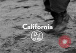 Image of men outside houses Sierra Madre California USA, 1954, second 2 stock footage video 65675052625