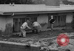 Image of men outside houses Sierra Madre California USA, 1954, second 13 stock footage video 65675052625