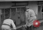 Image of men outside houses Sierra Madre California USA, 1954, second 14 stock footage video 65675052625