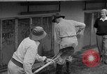 Image of men outside houses Sierra Madre California USA, 1954, second 15 stock footage video 65675052625