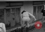 Image of men outside houses Sierra Madre California USA, 1954, second 17 stock footage video 65675052625