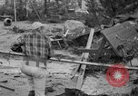 Image of men outside houses Sierra Madre California USA, 1954, second 27 stock footage video 65675052625