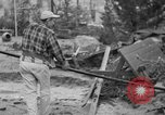 Image of men outside houses Sierra Madre California USA, 1954, second 28 stock footage video 65675052625