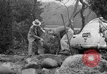 Image of men outside houses Sierra Madre California USA, 1954, second 30 stock footage video 65675052625