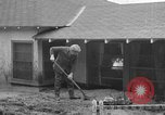 Image of men outside houses Sierra Madre California USA, 1954, second 32 stock footage video 65675052625