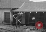 Image of men outside houses Sierra Madre California USA, 1954, second 34 stock footage video 65675052625