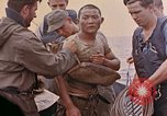 Image of US submarine rescues survivors from Japanese boat Pacific Ocean, 1945, second 18 stock footage video 65675052640
