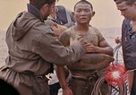 Image of US submarine rescues survivors from Japanese boat Pacific Ocean, 1945, second 19 stock footage video 65675052640