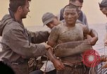 Image of US submarine rescues survivors from Japanese boat Pacific Ocean, 1945, second 20 stock footage video 65675052640