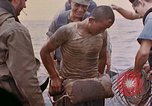 Image of US submarine rescues survivors from Japanese boat Pacific Ocean, 1945, second 23 stock footage video 65675052640